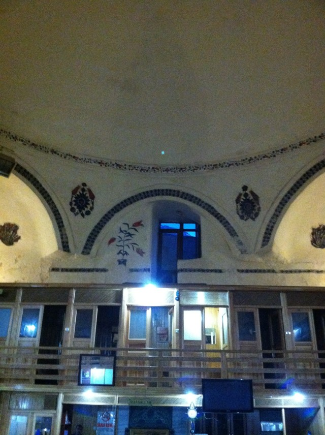 Upper and lower floors of changing rooms with a pretty, plaster, domed ceiling overarching the area.