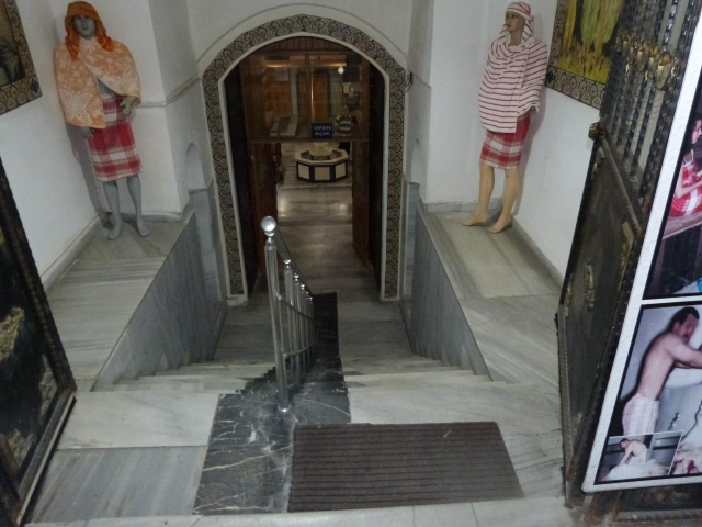 Heading down the steps into the entrance hall.